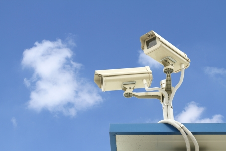 Security camera on blue sky background Stock Photo - 13904216