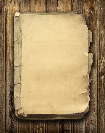 books on a wooden surface: Old book on wooden background