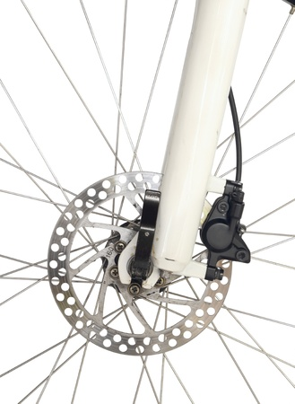 Front wheel brake of mountain bike isolated on white background photo