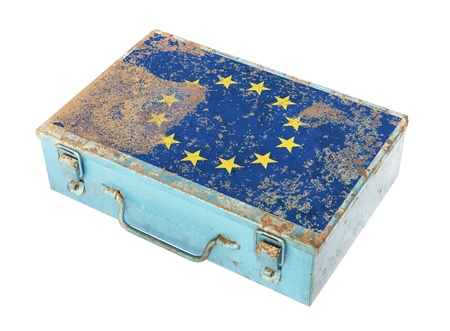 Rusty metal box with European flag on lid isolated on white background photo