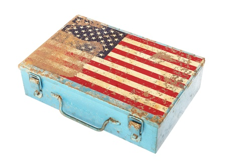 Rusty metal box with America flag on lid isolated on white background photo
