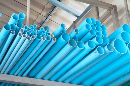 Pile of PVC pipes in warehouse