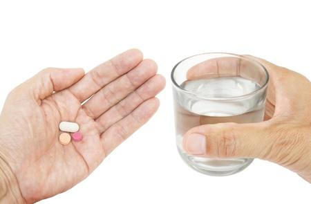 Pillen und Glas Wasser in der Hand isoliert auf weißem Hintergrund Standard-Bild - 14291519