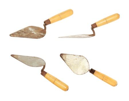 Rusty trowel set isolated on white background photo