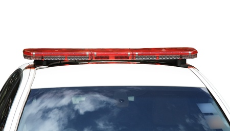 Red police car siren isolated on white background photo