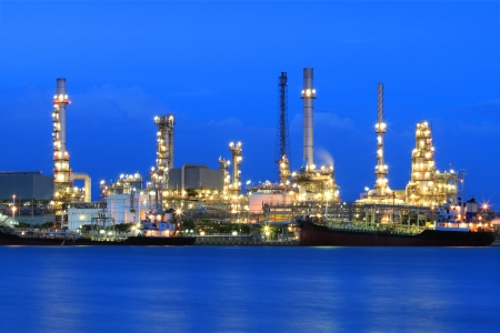 Oil refinery manufacturing at twilight photo