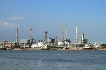 Oil refinery manufacturing with blue sky photo