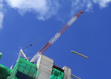 Hoist crane working on construction building photo