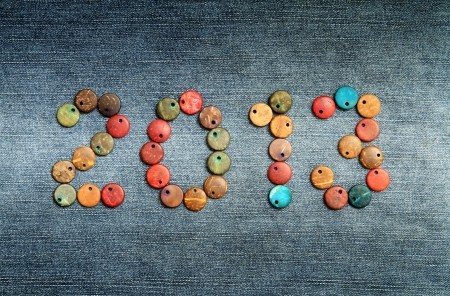 New year 2013, colorful beads on cloth background photo