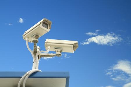 spy camera: Security camera on blue sky background