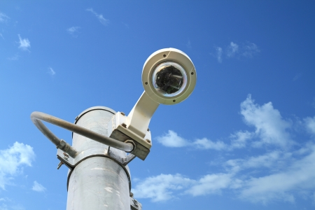 Security camera for car parking on blue sky background