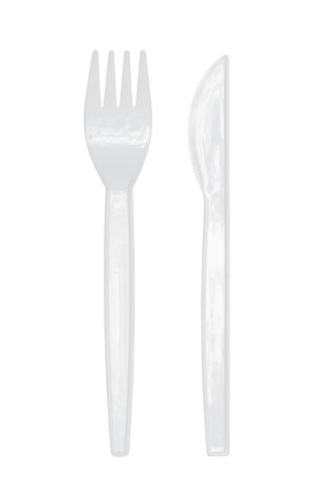 Plastic knife and fork isolated on white background photo