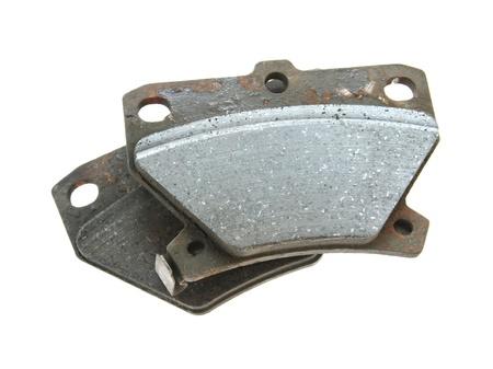 expire: Used brake pads isolated on white backgroun