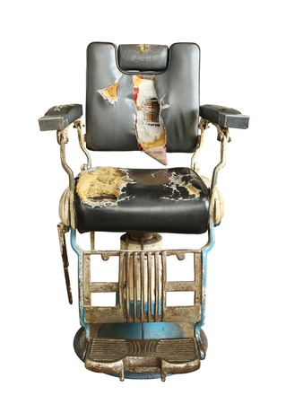 Vintage barber chair isolated on white background photo