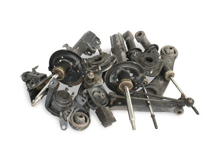 Pile of used auto parts isolated on white background