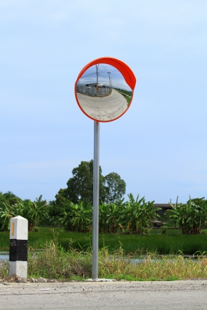 convex: Convex mirror on the road with blue sky Stock Photo