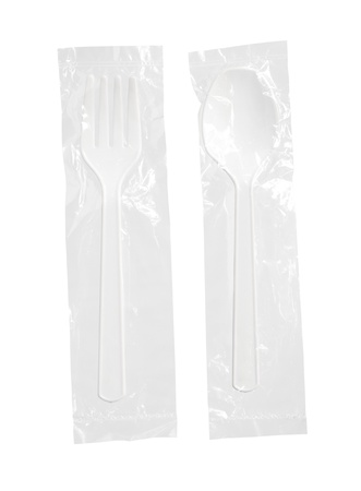 Plastic spoon and fork in bag isolated on white background photo