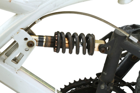 absorber: Adjustable shock absorber with spring on bicycle isolated on white background