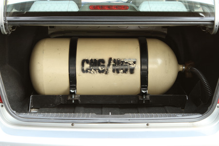 ngv: CNG NGV gas storage tank for alternative fuel on a car Stock Photo