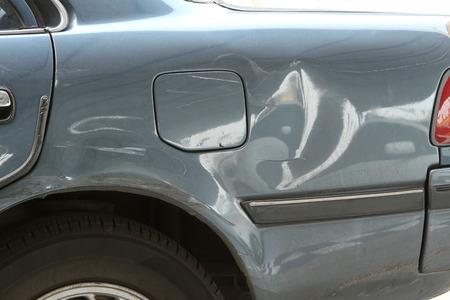 Damaged car, dented on an old car