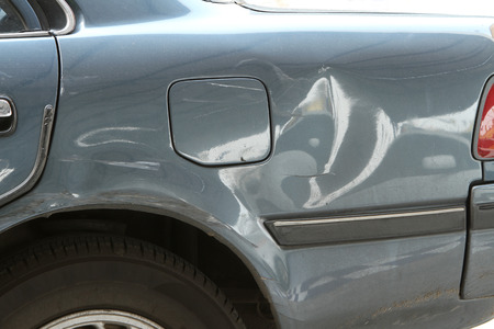 Damaged car, dented on an old car