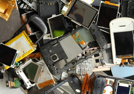 broken telephone: Pile of mobile phone scrap Stock Photo