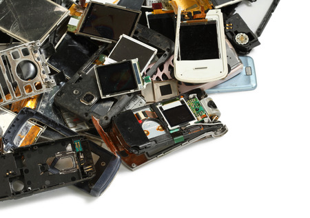 Pile of mobile phone scrap isolated on white background photo