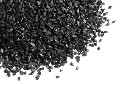 Granular activated carbon for water filter on white background