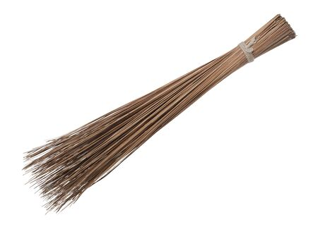 Coconut leaf broomstick rough duster sweeper isolated on white background