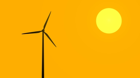 Silhouette of a wind turbine operating at sunset Stock Photo