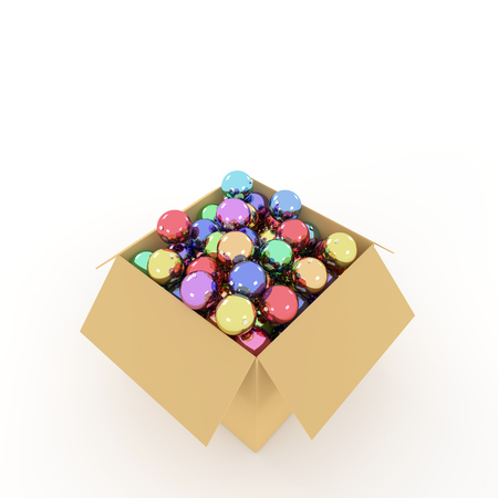 Cardboard box filled with colored Christmas balls