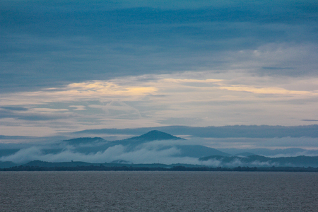 hopelessness: Sea Mountain and the mist with mostly sunset in eat of thailand