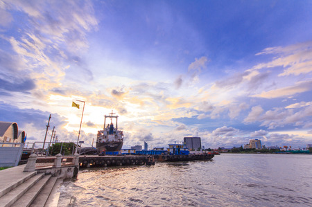 chao praya: Pier and Port near Chao Praya river and water traffic transportation from Day to Night