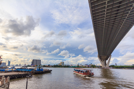 timelapse: The Port, the Pier and the Bridge in evening time with stratus clouds night in Bangkok, Thailand.