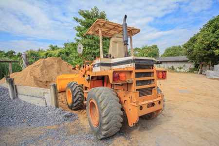 Yellow Construct Tractor vintage Loader, Sand Loader Stock Photo