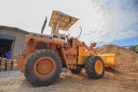 landfill site: Yellow Construct Tractor vintage Loader, Sand Loader Stock Photo