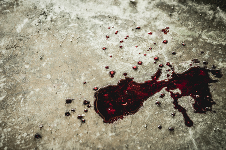 A drop of blood on a hunk of dirt in an abandoned house them. Background operators in Halloween festivities. The story about the murder Фото со стока