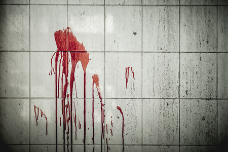 A drop of blood on a wall in an abandoned house them. Background operators in Halloween festivities. The story about the murder 写真素材