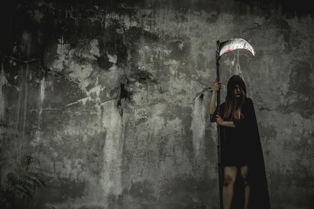Girld dress black as angel of death and kira angkor in Halloween festival. Halloween concept. Psychopomps.
