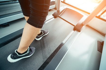 Asian woman exercising in the gym, Young woman workout in fitness for her healthy and office girl lifestyle. She is running on treadmill in fitness. Reklamní fotografie - 110782374