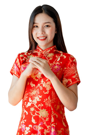 Asian woman wearing red Chinese dress or Qi Pao in Chinese new year festival. Stock Photo
