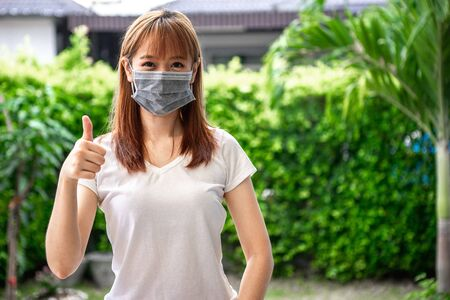 Asian teenage girls are wearing masks to protect themselves from dust and prevent the spread of coronavirus or covid-19 outbreaks to work from home.