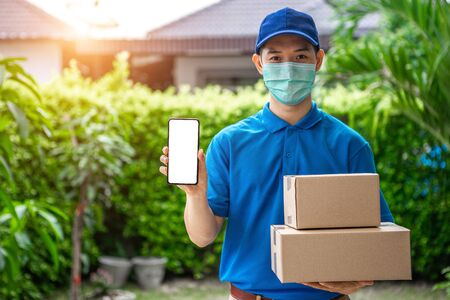 Asian deliveryman staff are preparing packages to deliver to customers who order online during the coronavirus or covid-19 outbreak.