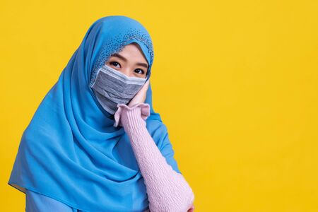 Asian muslim woman in medical mask Coronavirus pandemic disease isolate background. COVID-19 virus epidemic outbreak.