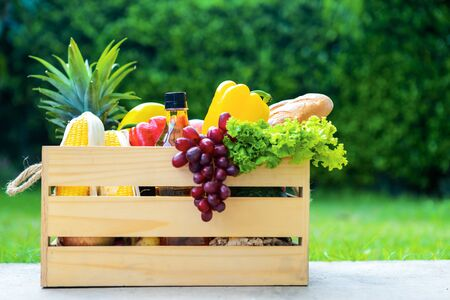 Wooden basket with vegetables. fresh vegetables in a basket. picnic in the garden. Stay at home. Enjoy cooking at home. Family concept.