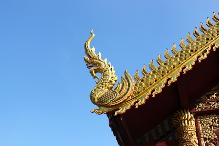Gable apex in temple roof with blue sky background