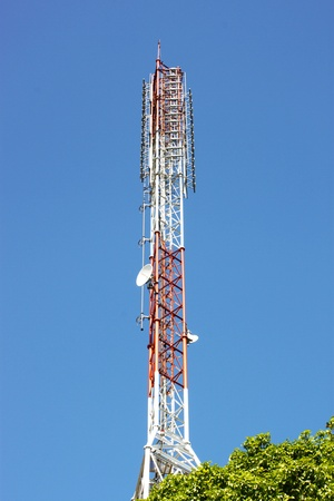 Radio Antenna on blue sky photo