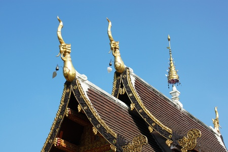 detail of ornately decorated temple roof in chaingmai, thailand  photo