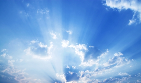 sky and clouds: Beautiful blue sky with sunbeams and clouds.  Stock Photo