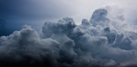 dark cloudy stormy sky with clouds photo